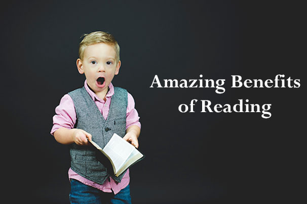 A Boy Holding a Book and Looking Amazed